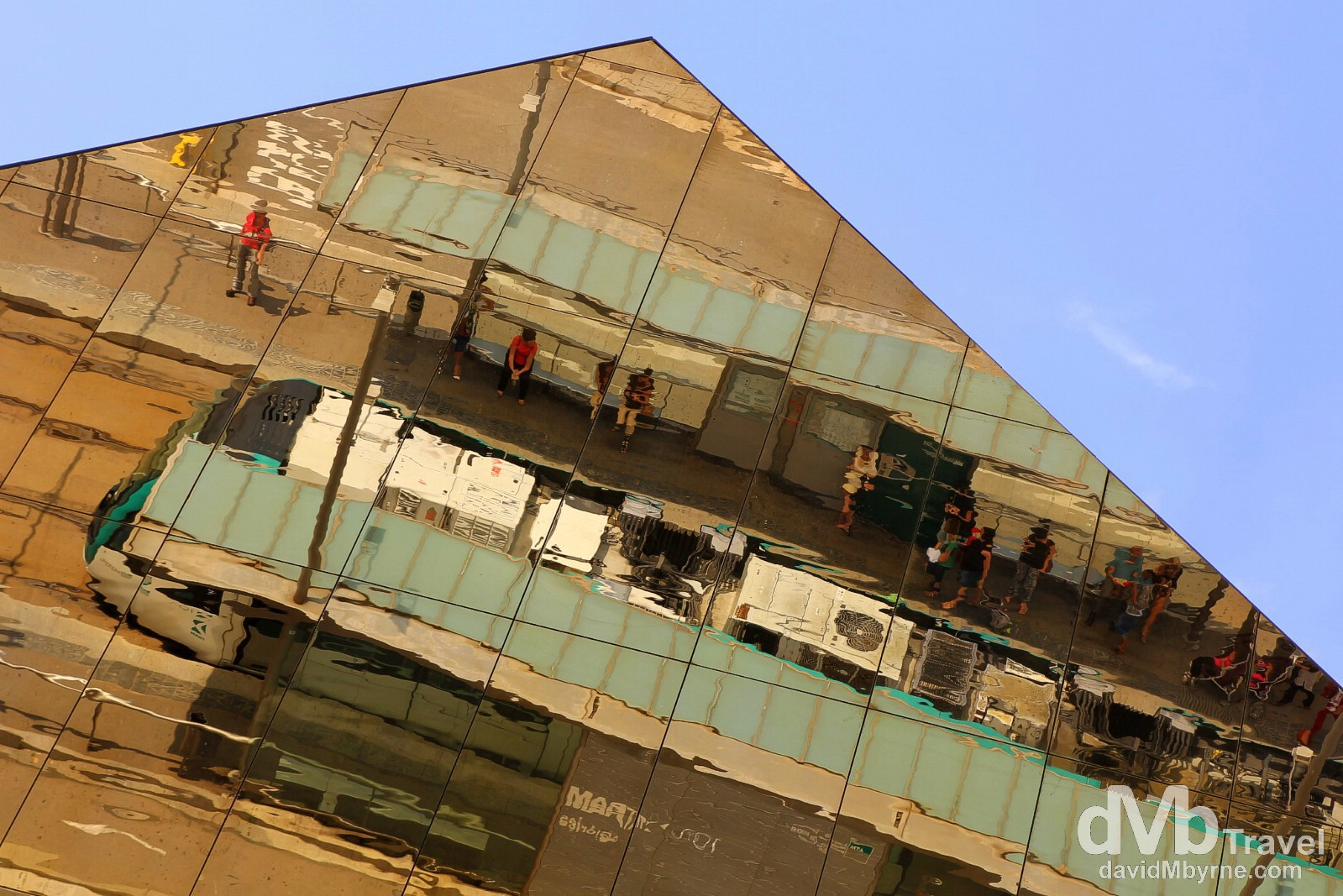 Overhead tram stop reflections on Avenue Meridiana in Barcelona, Spain. June 17th, 2014.
