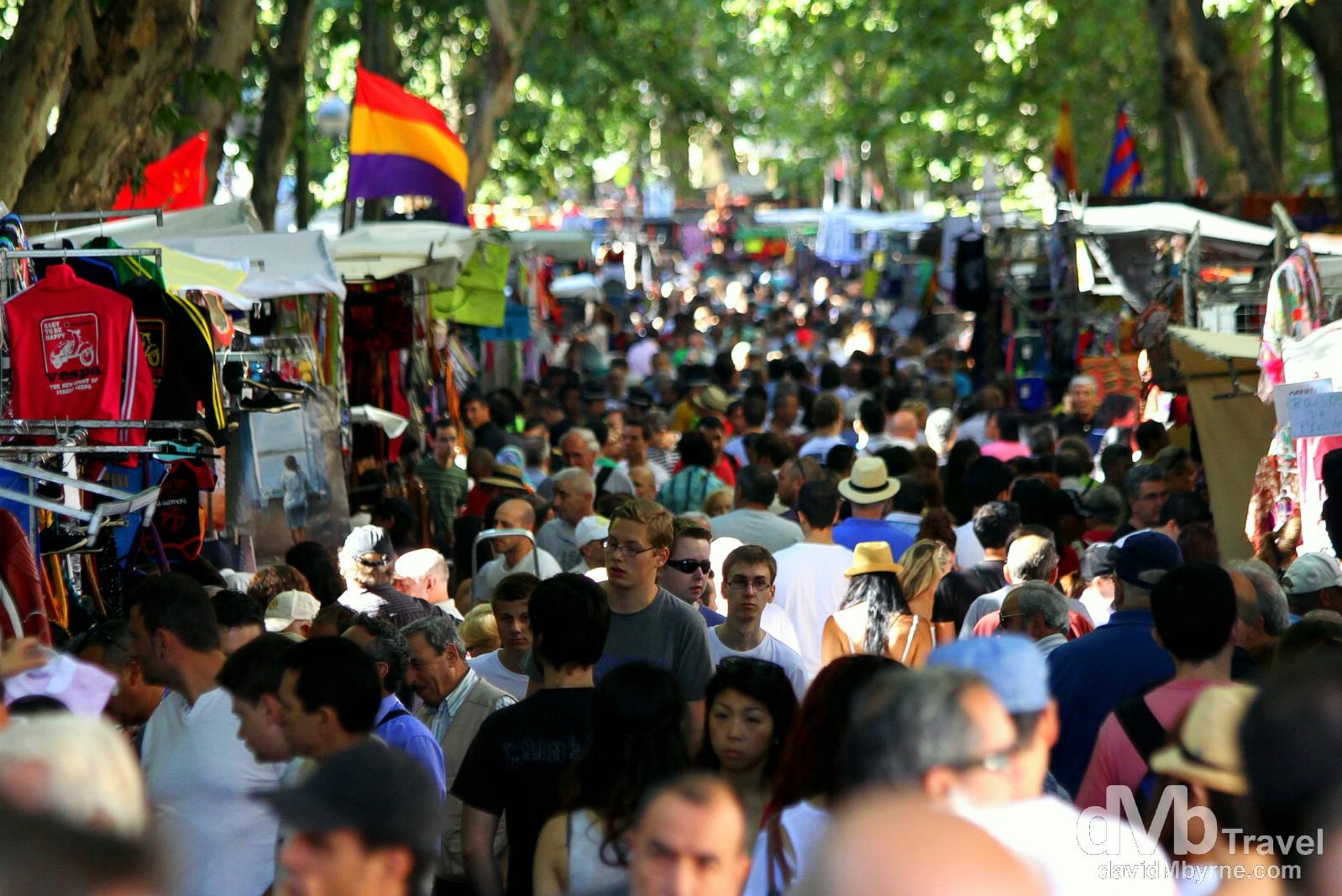 El Rastro flea market monopolising Ribera de Curtidores in Madrid, Spain. June 15th, 2014.