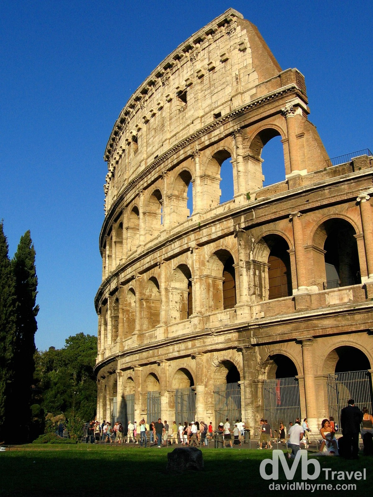 Walking by a section of the external facade of the Colosseum in Rome, Italy. September 1st, 2007.