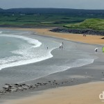 Surfers in the water of the beach in Lahinch. Co. Kerry, Ireland. August 27, 2014.
