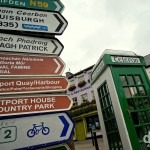 Street signs and an old school telephone box in Westport, Co. Mayo, Ireland. August 26, 2014.