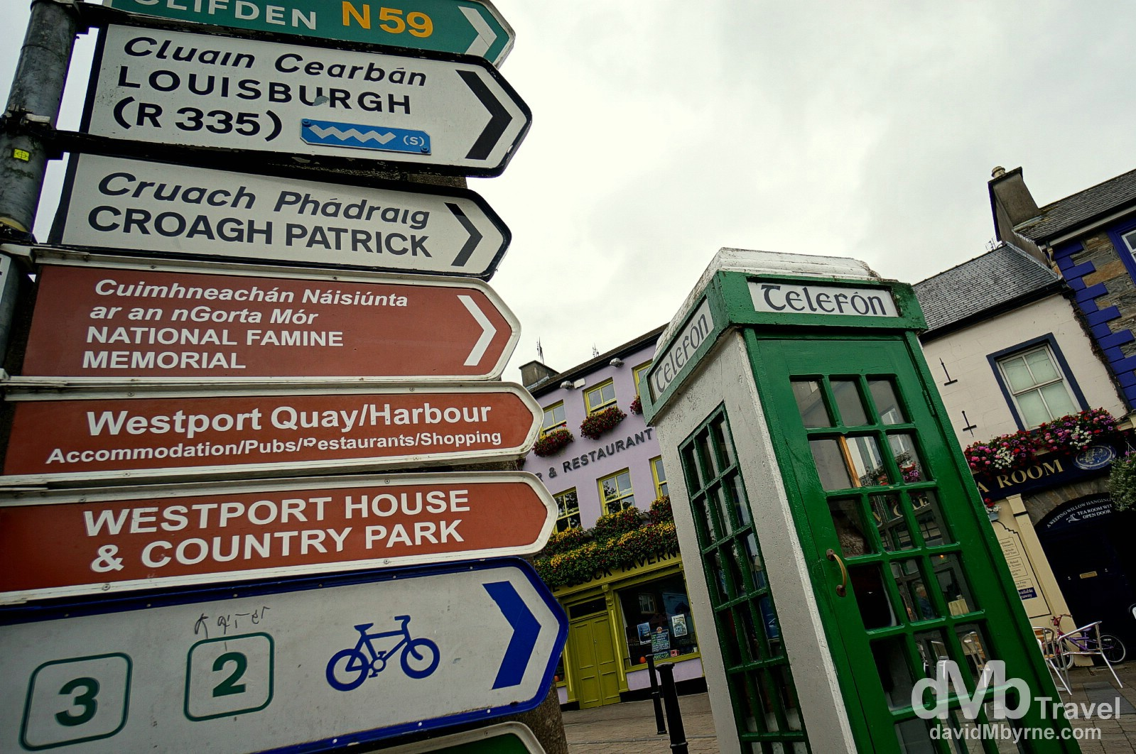 Street signs and an old school telephone box in Westport, Co. Mayo (map marker H), Ireland. August 26, 2014.