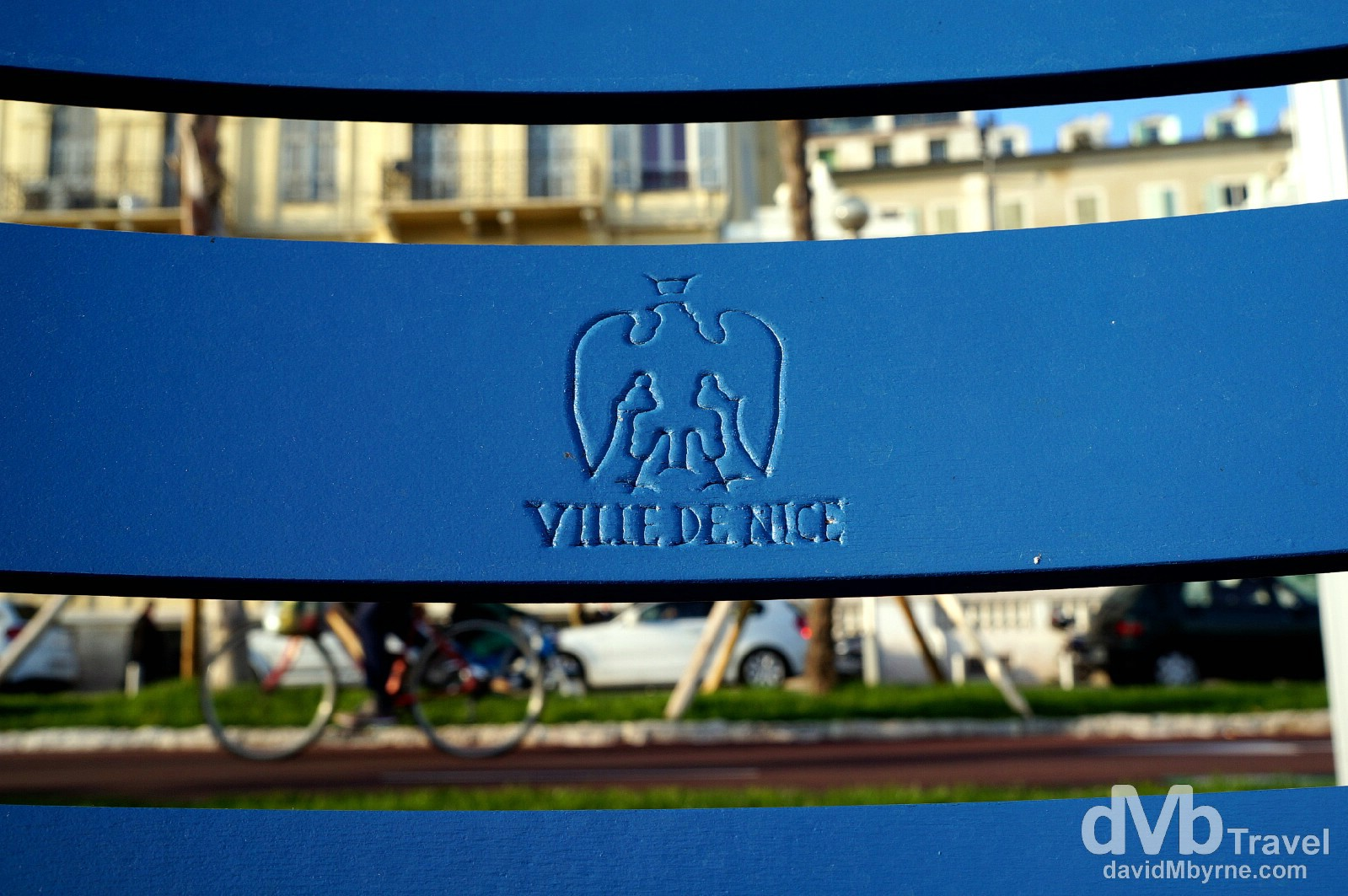 Distinctive blue seats on the beachfront Promenade des Anglais, Nice, Côte d'Azur, France. March 14, 2014.