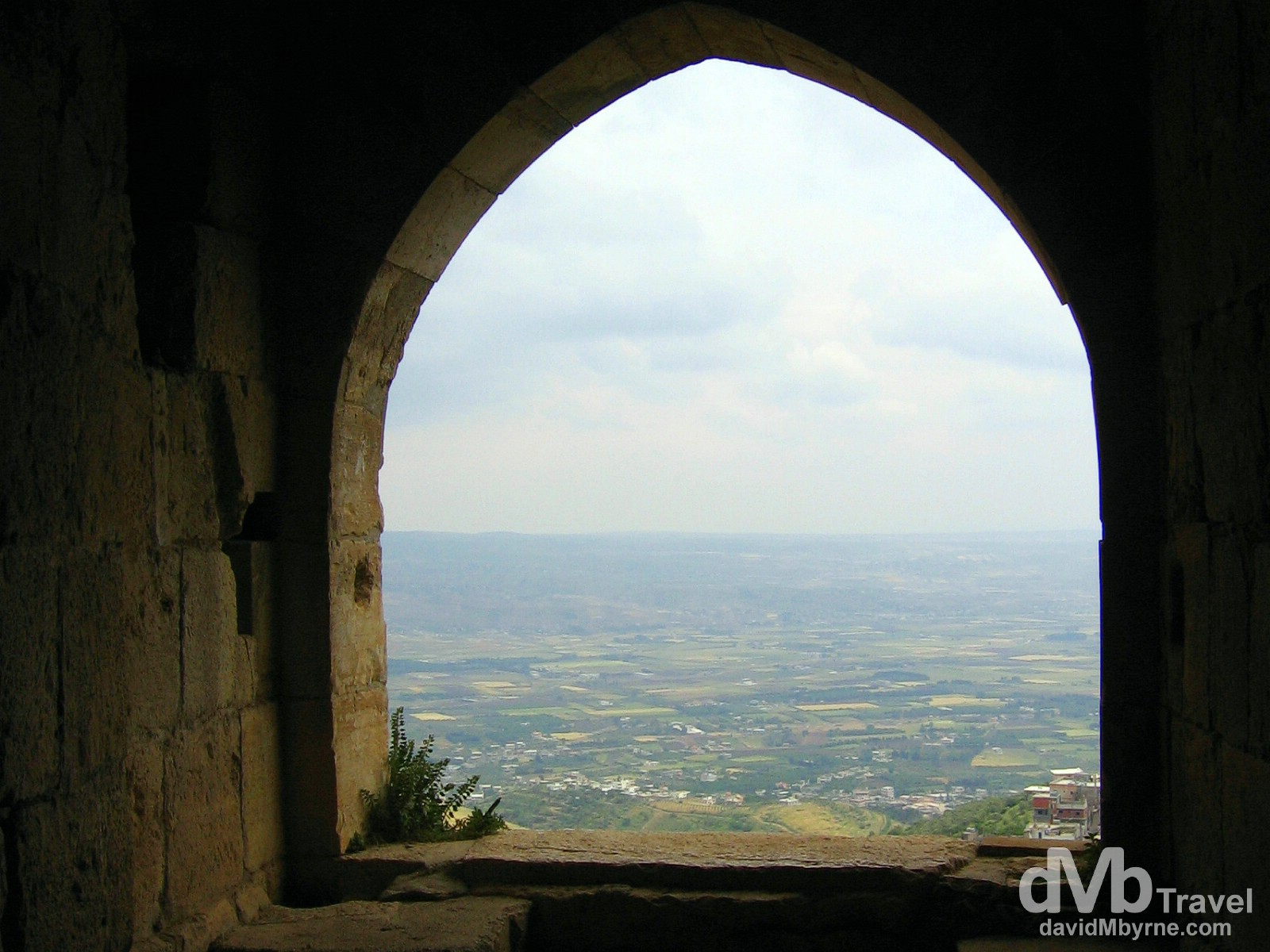 The view of the Syrian countryside from an opening of the Crusader castle Crac des Chevaliers. May 7, 2008.