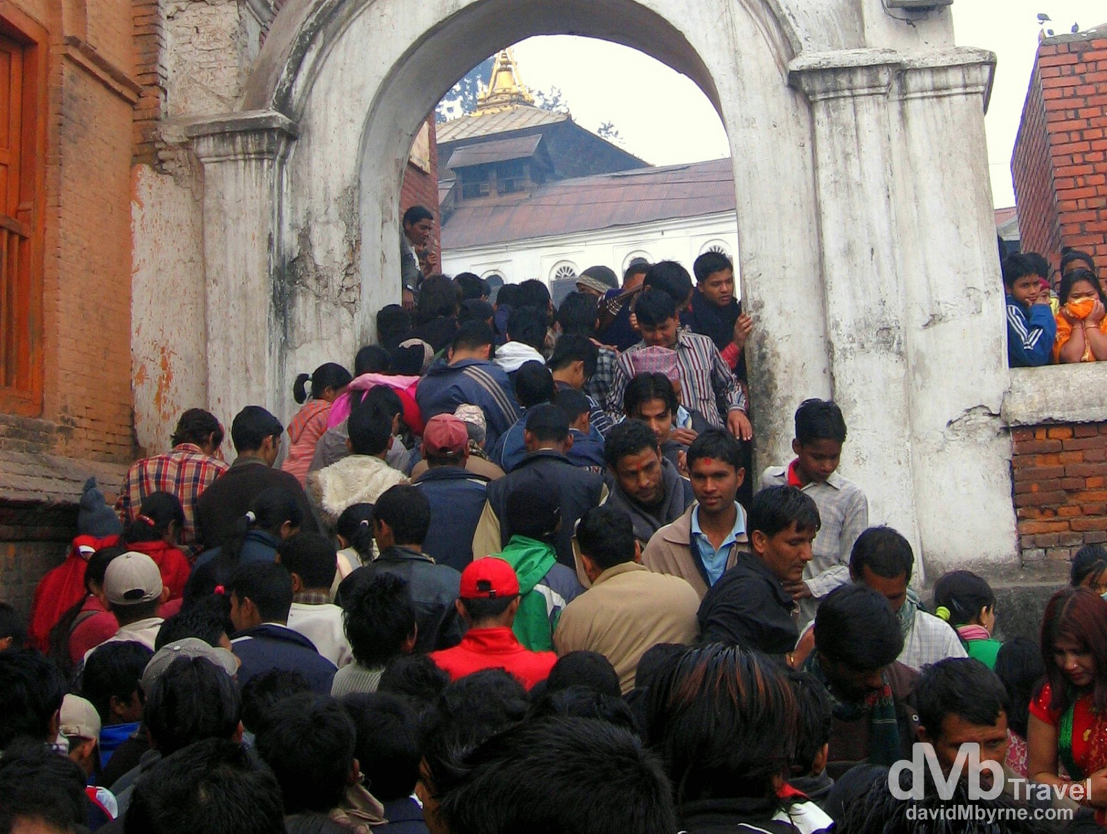 Crowds in the grounds of the Pashupatinath temple on the day of the festival celebrating the birthday of the Hindu god Shiva. Kathmandu, Nepal. March 6, 2008.