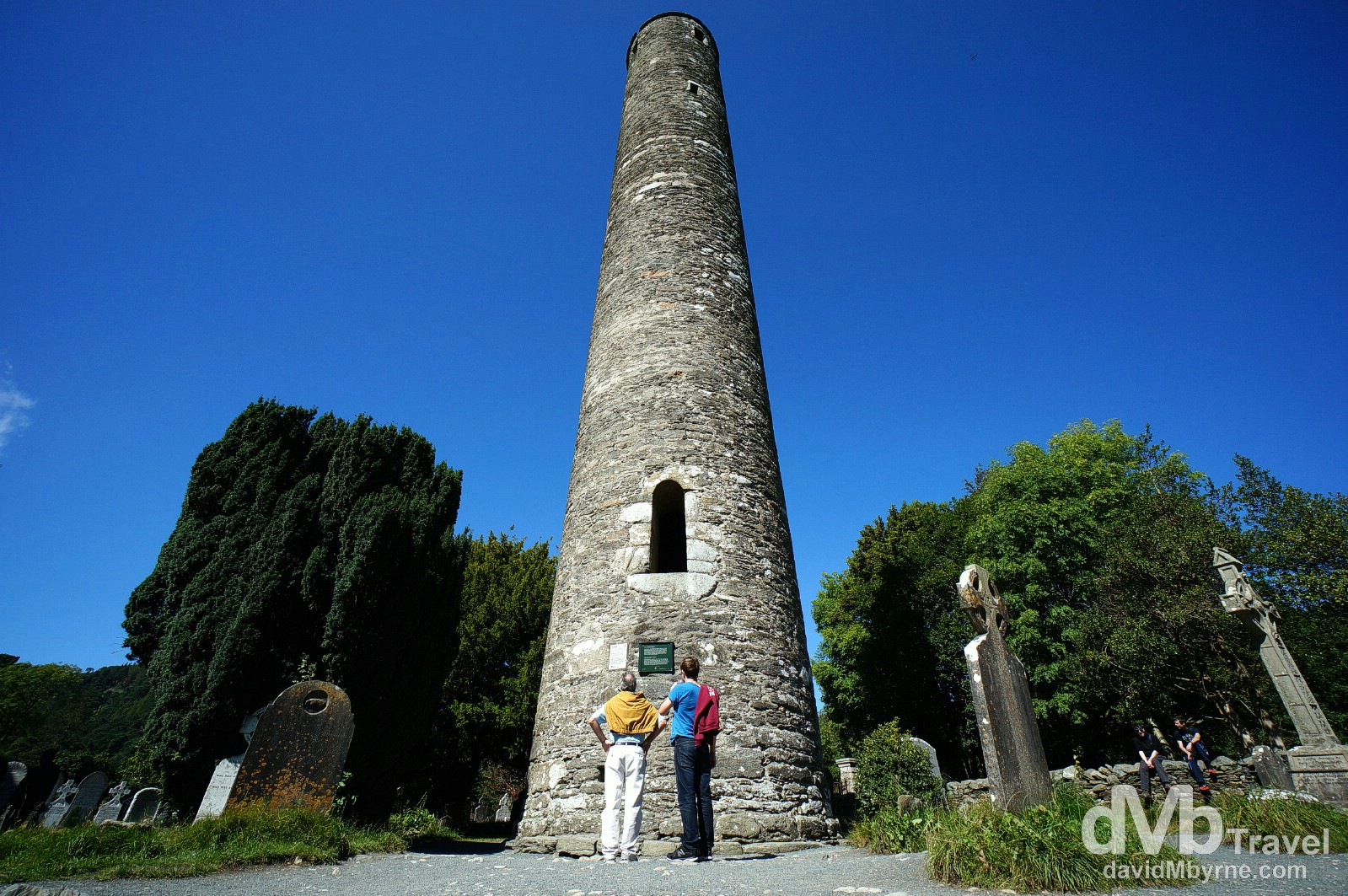 Admiring the Round Tower in Glendalough, Co. Wicklow, Ireland. August 31, 2014.