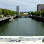 Graffiti on the Ha'penny Bridge spanning the River Liffey in Dublin, Ireland. September 1, 2014.
