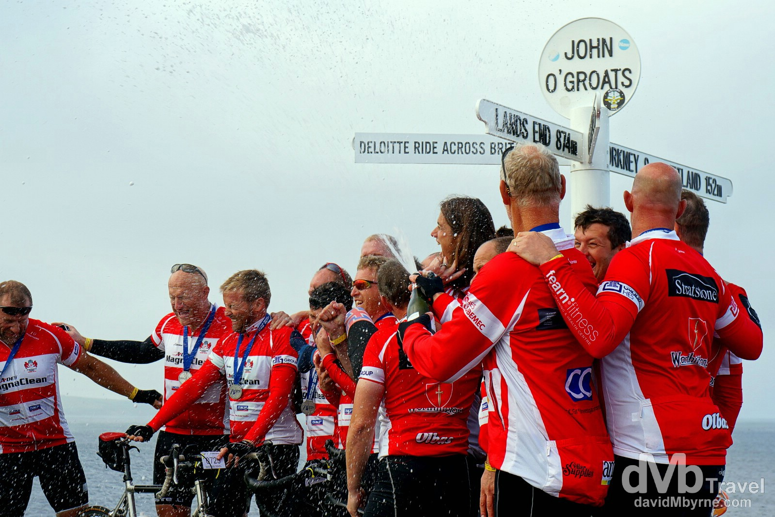 Deloitte Ride Across Britain 2014 participants celebrate completing the 9-day, 874 mile cycle from Land's End by the post at John O'Groats in Scotland. September 14, 2014.
