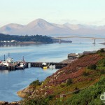 The mountains of the Isle of Skye & The Skye Bridge spanning Loch Alsh as seen from the A87 entering Kyle of Lochalsh, Highland, Scotland. September 17, 2014.
