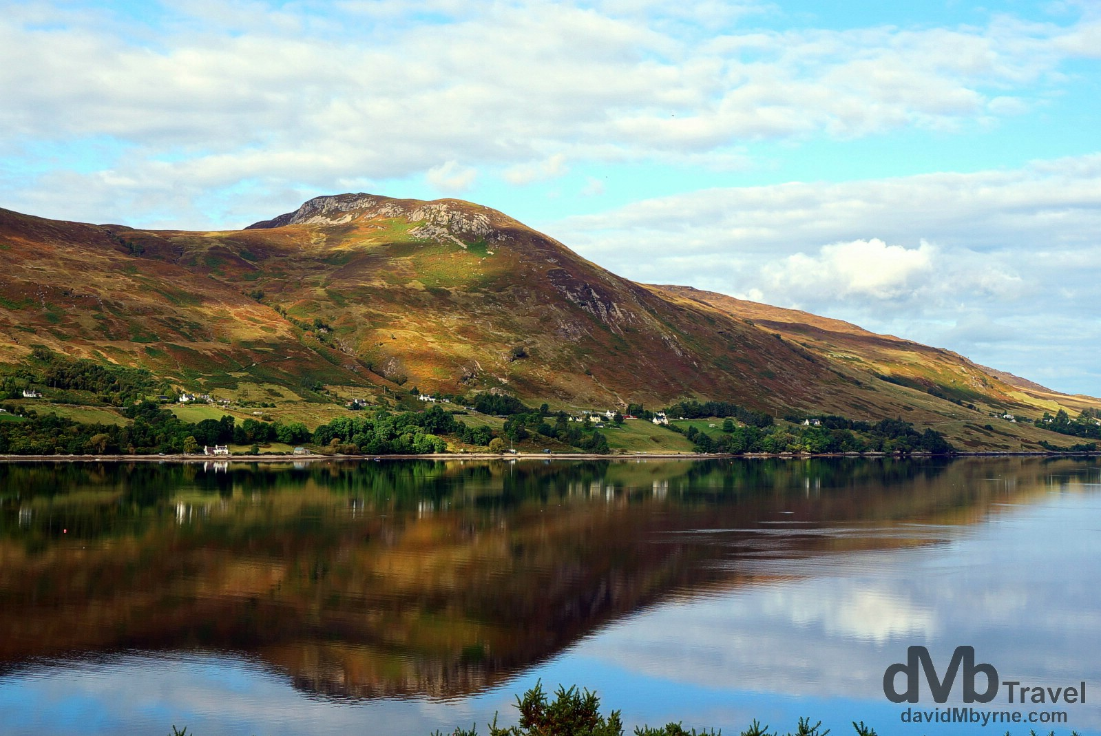 Reflections of the western shore of Lock Broom, Highlands, Scotland. September 16, 2014.