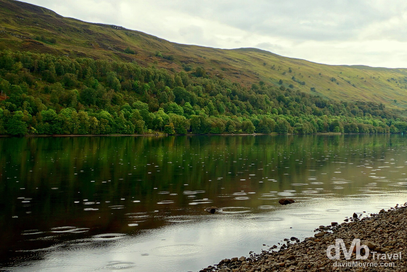 Light rain disrupts the mirror-like reflections on Loch Oich in Highland, Scotland. September 16, 2014.