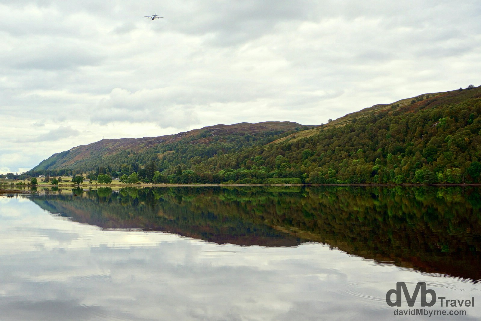 A military cargo plane fly-by over the waters of Loch Oich, Highlands, Scotland. September 16, 2014.