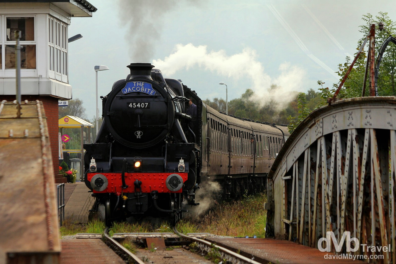 The famous Jacobite steam train passing through Banavie station en route from Fort William to Mallaig in Highland, Scotland. September 18, 2014.