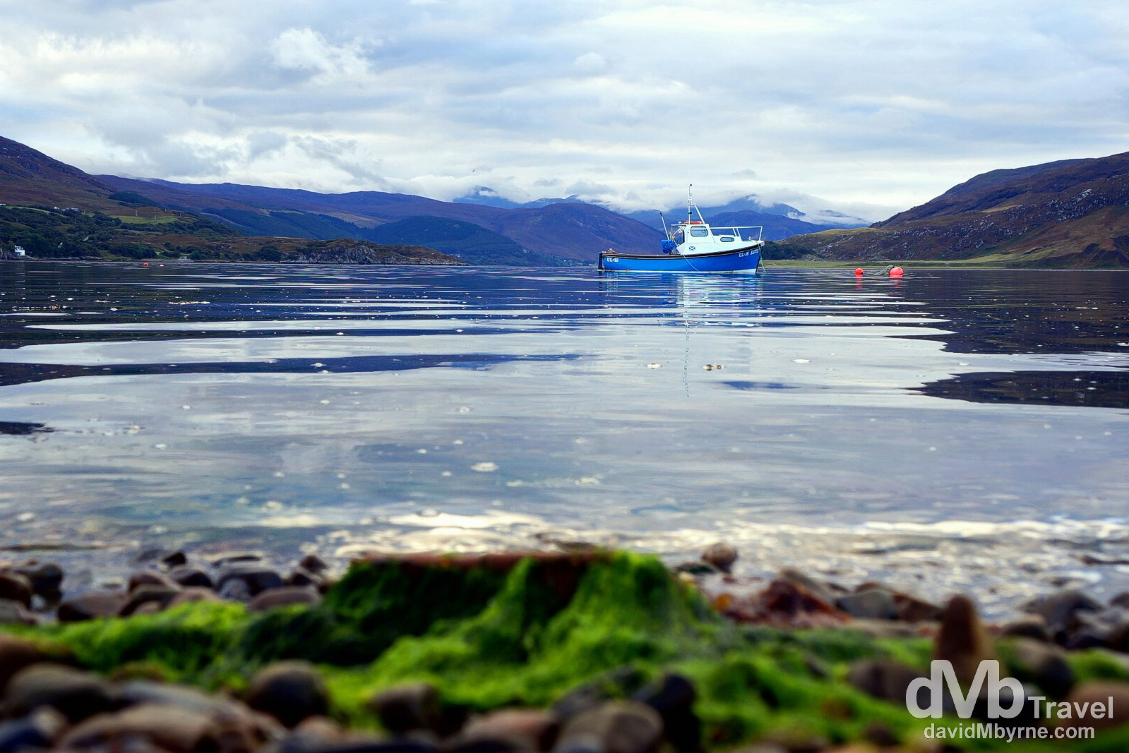 A lone boat in the harbour of Ullapool, Highlands, Scotland. September 16, 2014.