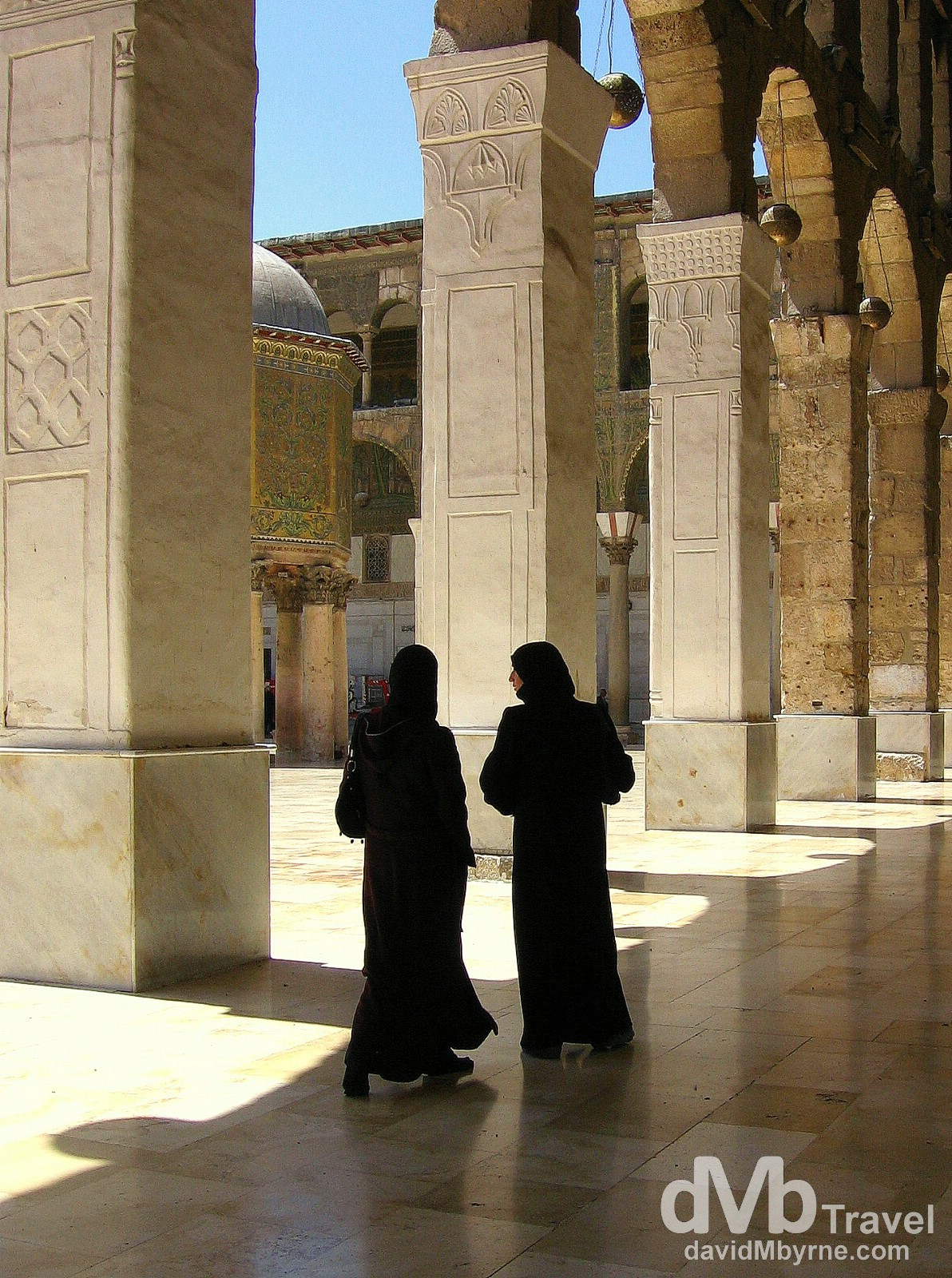 Two visitors in the courtyard of The Umayyad Mosque, aka The Great Mosque of Damascus, in Damascus, Syria. May 5, 2008.