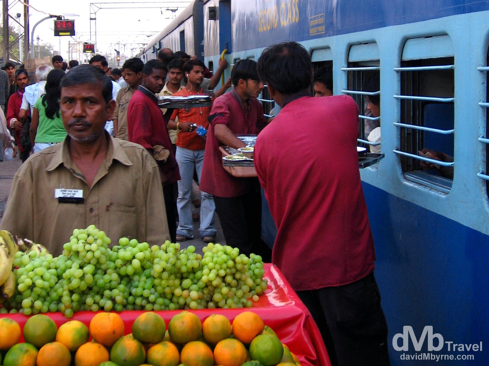 Vendors tending to the passengers on the Goa Express from the platform of Agra train station, India. March 26, 2008.