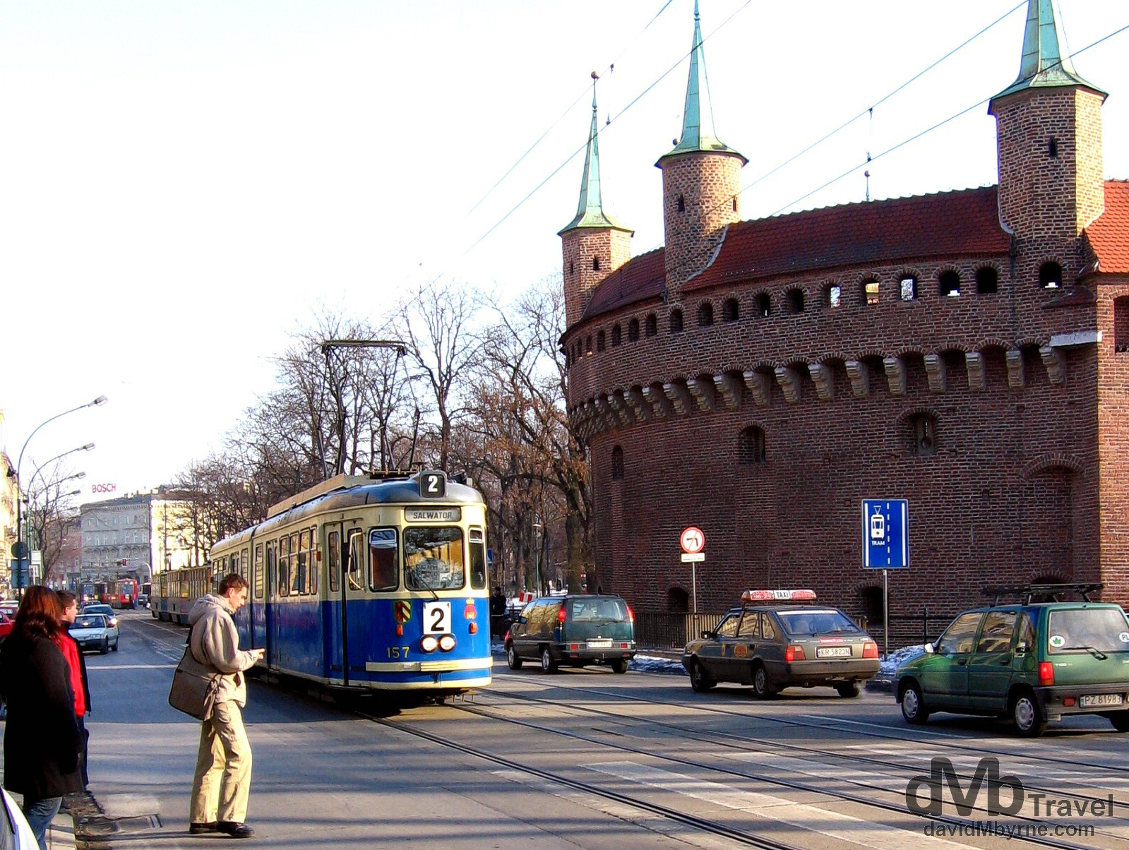 A tram plying the street fronting the circular Barbican, a defensive bastion built in 1498 as an outer defense to the city of Krakow in Poland. March 6, 2006.