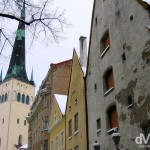Buildings facades & the spire of the Oleviste Church in the Old Town of Tallinn, Estonia. March 2, 2006.