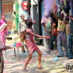 Indians enjoying the Hindu Colour Festival on the Main Bazaar of Paharganj. Delhi, India. March 22, 2008.