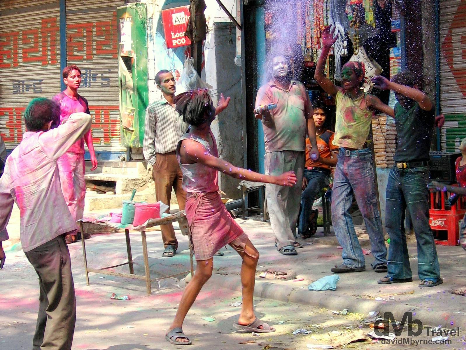Indians enjoying the Hindu Colour Festival on the Main Bazaar of Paharganj. Delhi, India. March 22, 2008.
