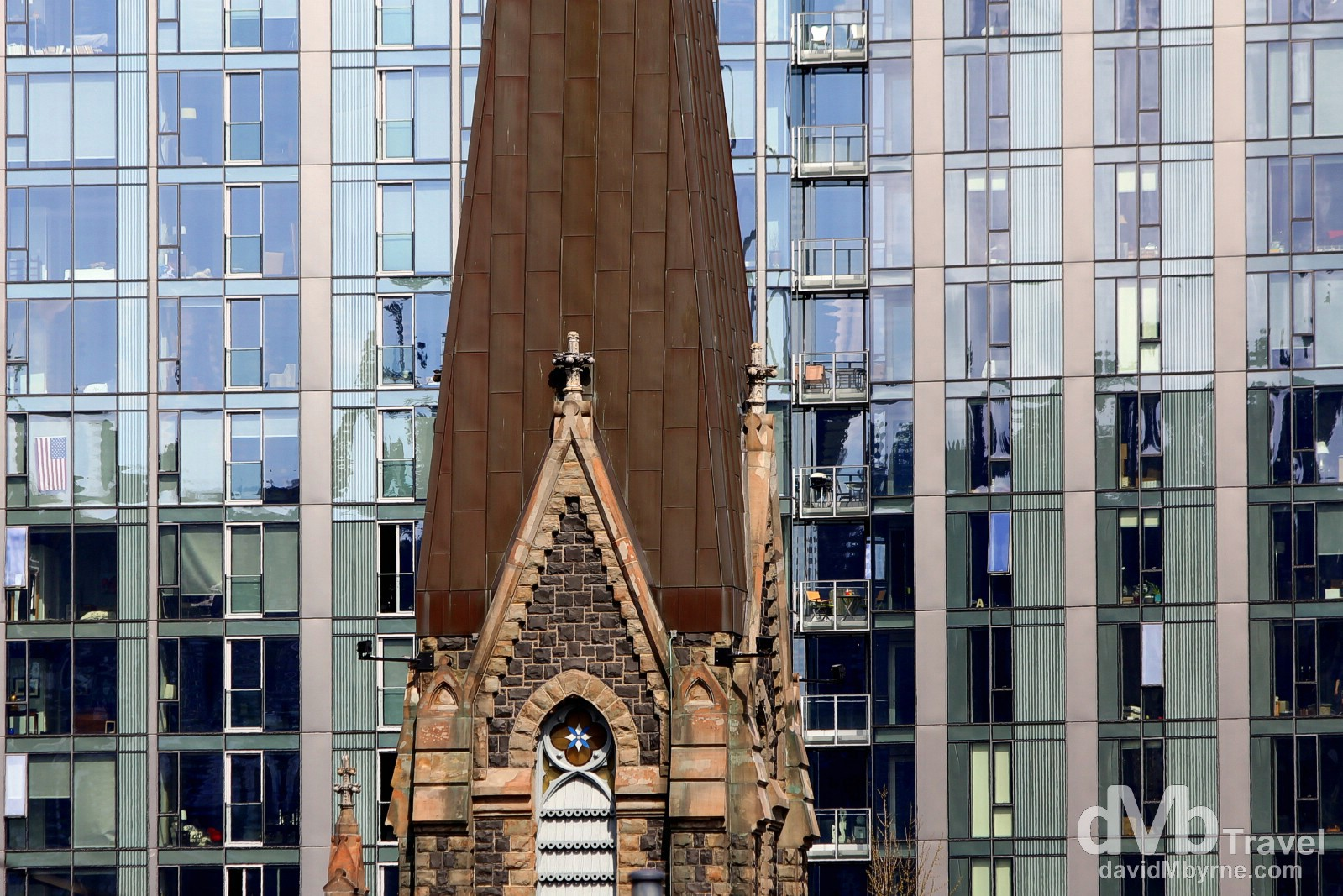 Old & new. A portion of the spire of the First Presbyterian Church set against an office & residential block in Portland, Oregon, USA. March 28, 2013.