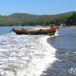 A fisherman bringing a boat ashore on Palolem Beach, Goa, India. April 1, 2008.