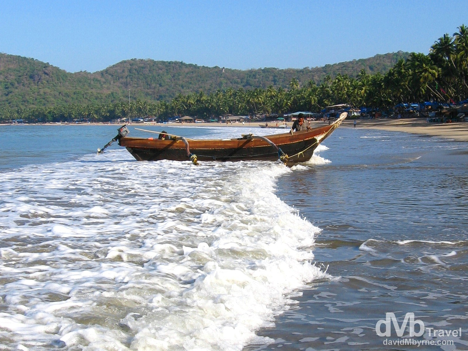 A fisherman bringing a boat ashore on Palolem Beach, Goa, India. April 1, 2008.