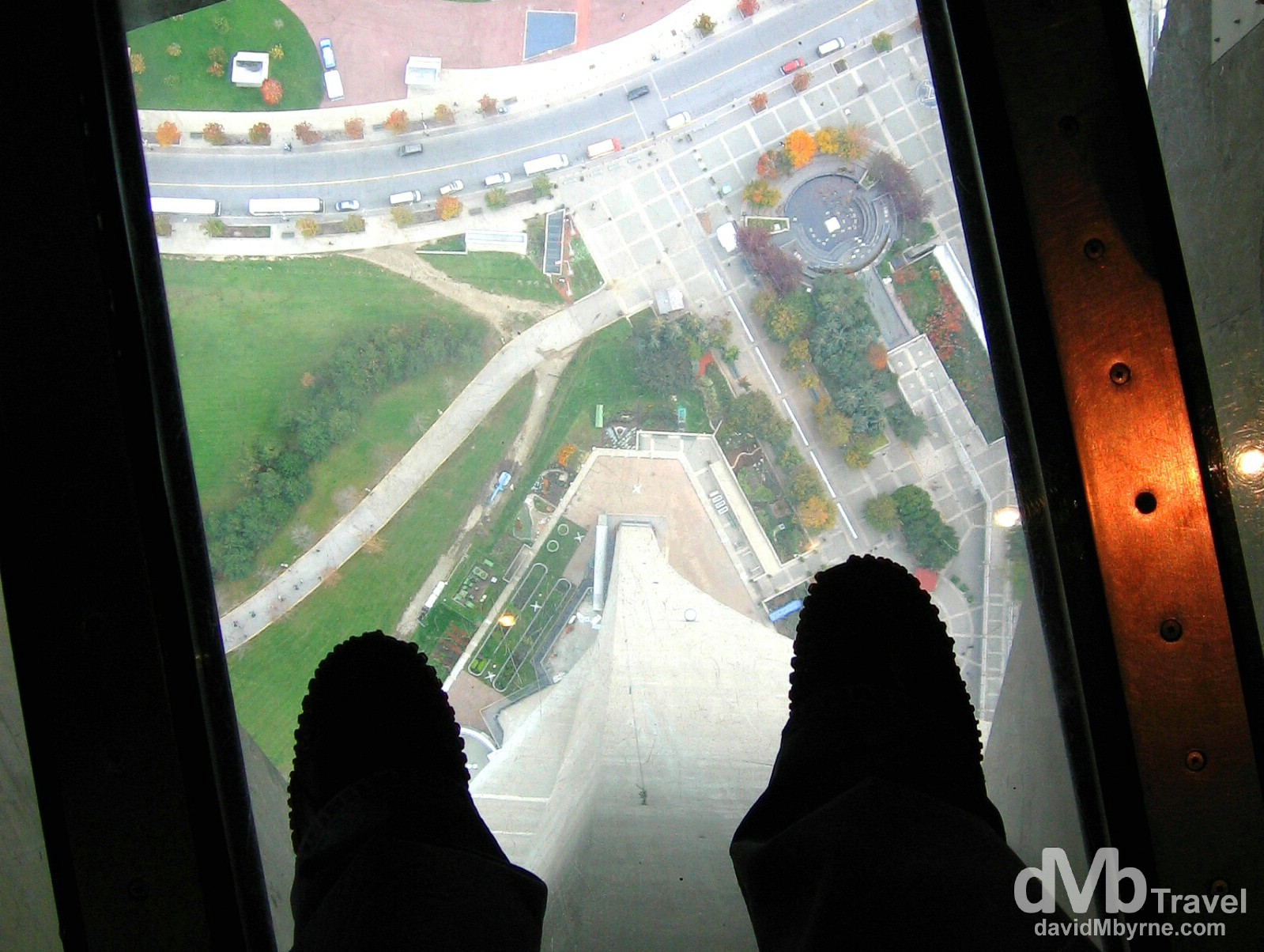 Standing on the glass floor of the viewing deck of the CN Tower in Toronto, Ontario, Canada. October 10, 2006.