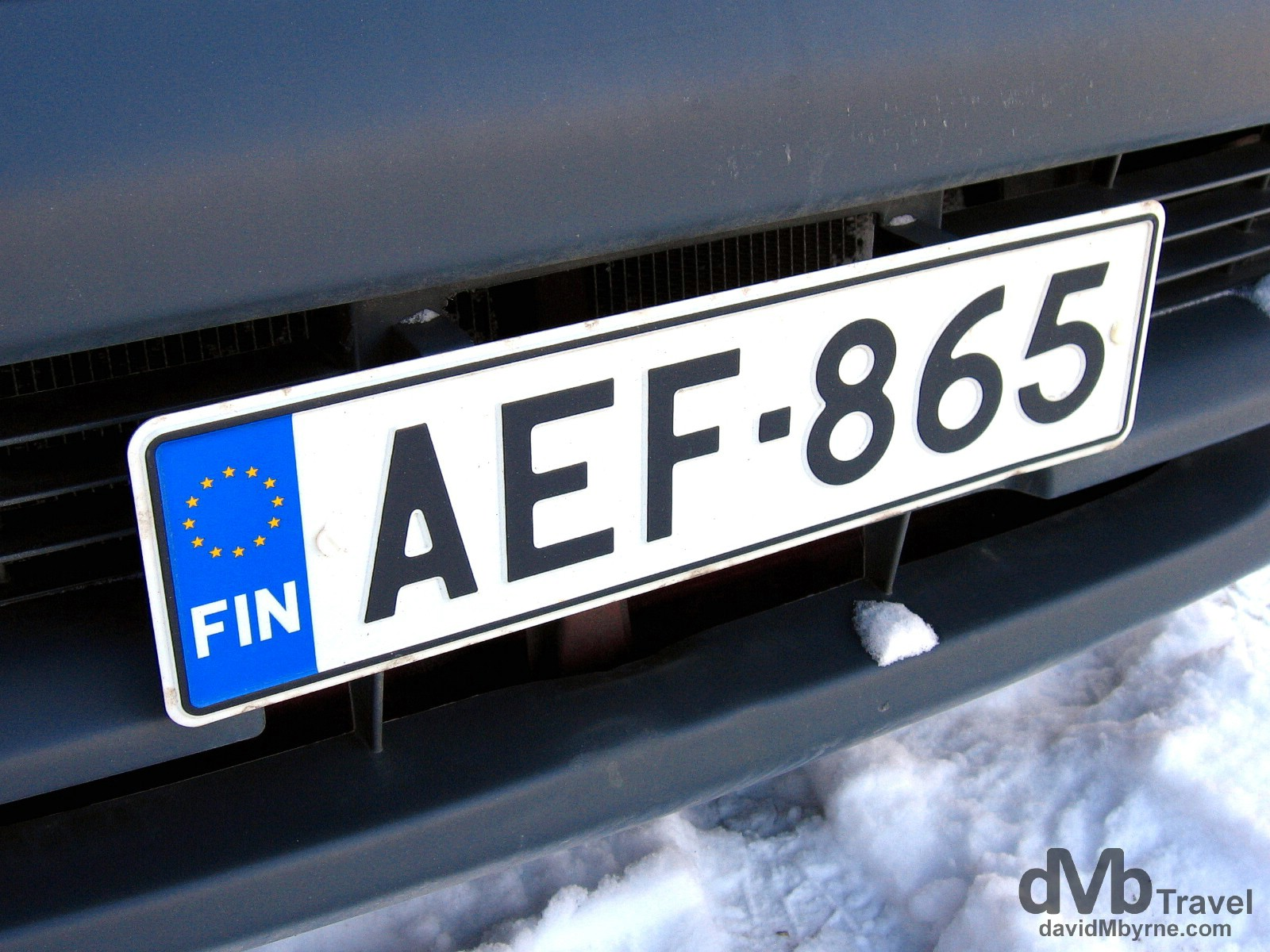 A car license plate on the snowy streets of Helsinki, Finland. March 1, 2006.