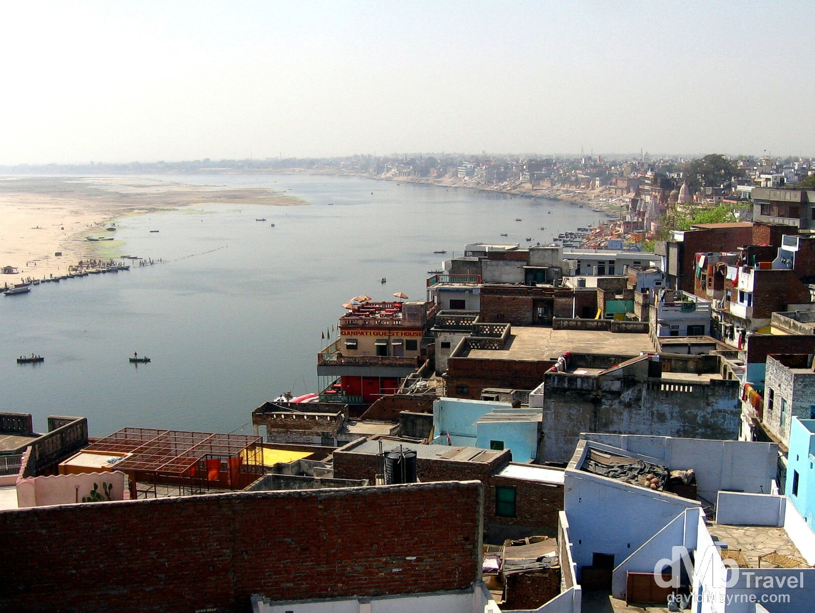 A view of Varanasi and the sacred River Ganges from the rooftop of the Puja guesthouse. Varanasi, Uttar Pradesh, India. March 17, 2008.