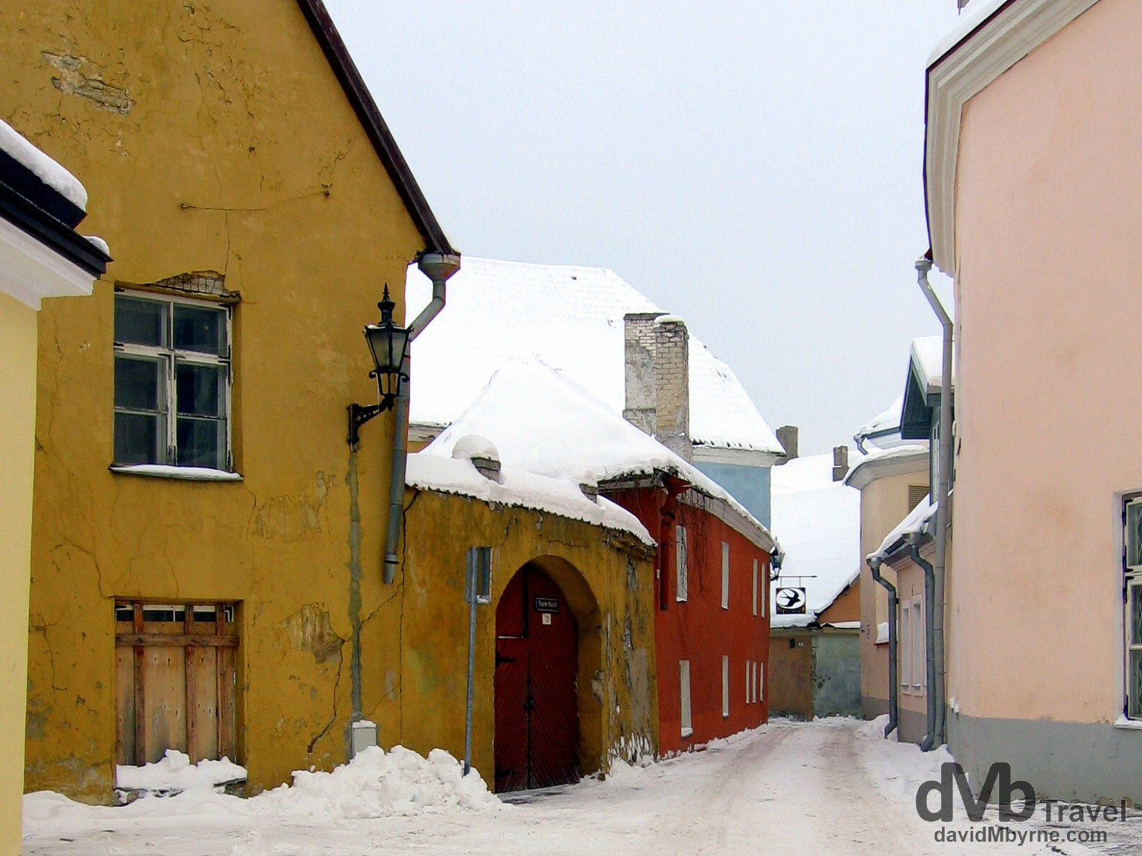 Colourful pastel buildings on the wintry streets of Old Town, Tallinn, Estonia. March 2, 2006.