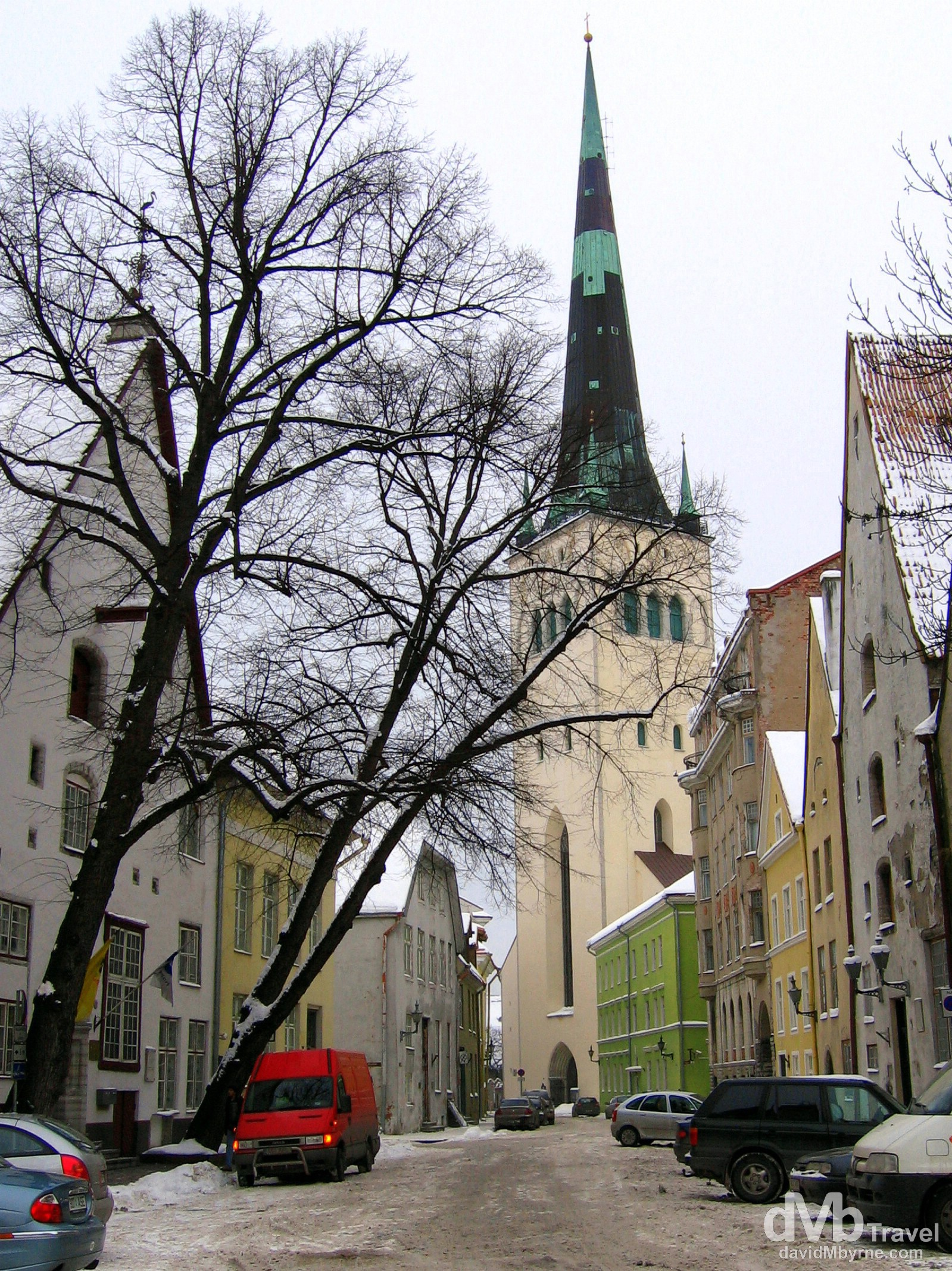 The Oleviste Church towering over a  Pikk tanav in the Old Town of Tallinn, Estonia. March 2, 2006.