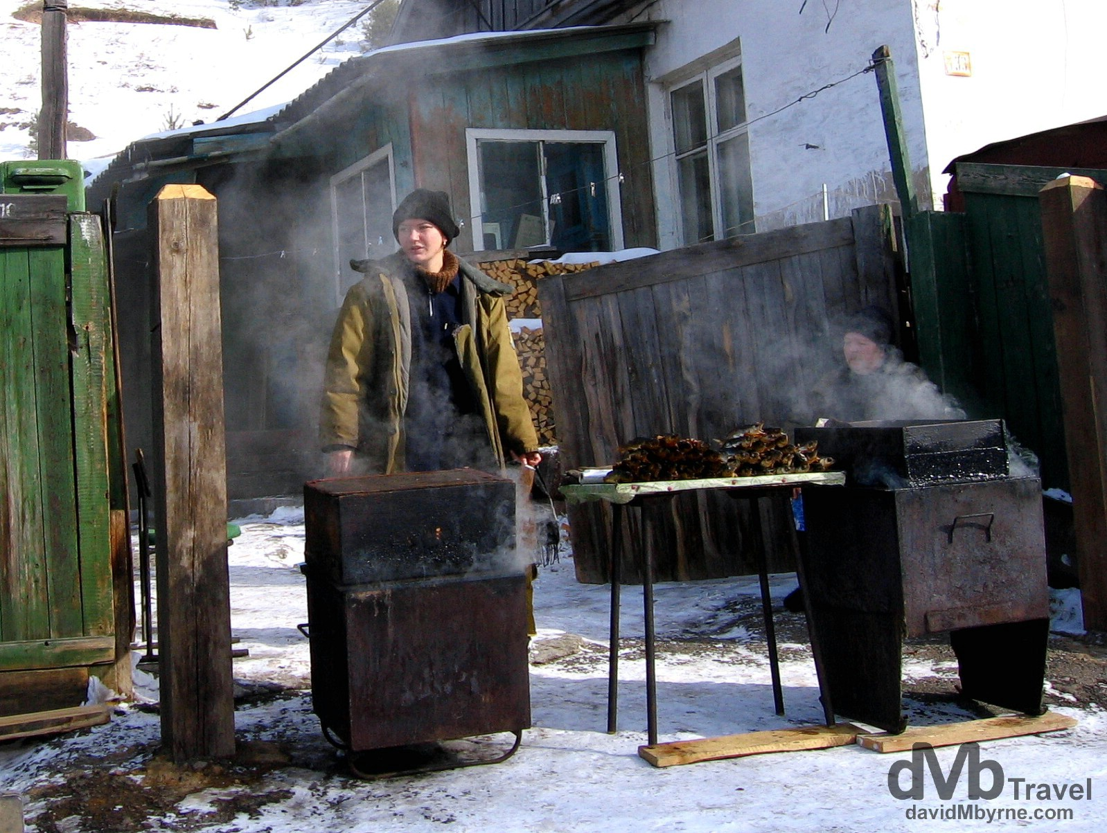 Omul sellers in the village of Listvyanka on the shores of Lake Baikal in Siberian Russia. February 18, 2006.