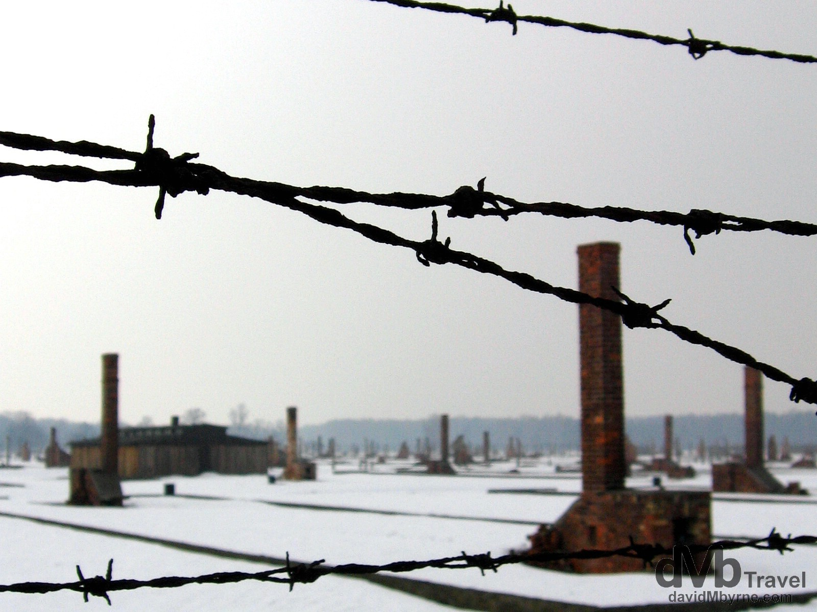Remnants of the horrific past as seen through the fencing of the Birkenau Concentration Camp in Brzezinka, Poland. March 7, 2006,