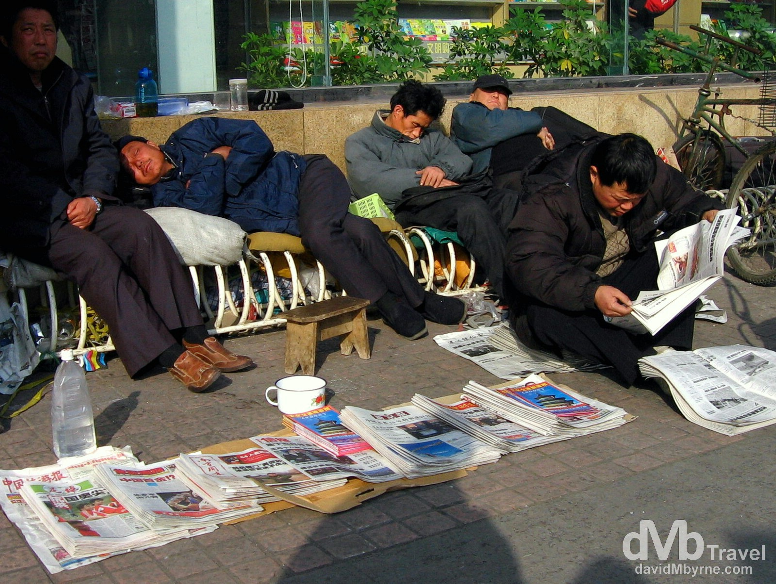 Snoozing on the streets of Beijing, China. February 10. 2006.