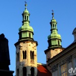 The silhouette of a statue & twin spires of Saint Andrew's Church in Old Town, Krakow, Poland. March 6, 2006.