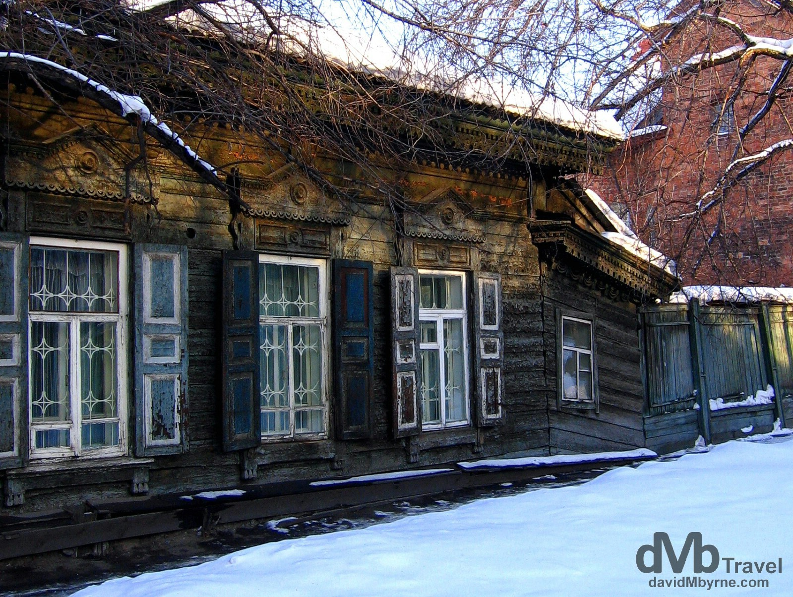 Crumbling wooden buildings on Ul Chkalova, Irkutsk, Siberian Russia. February 17, 2006.