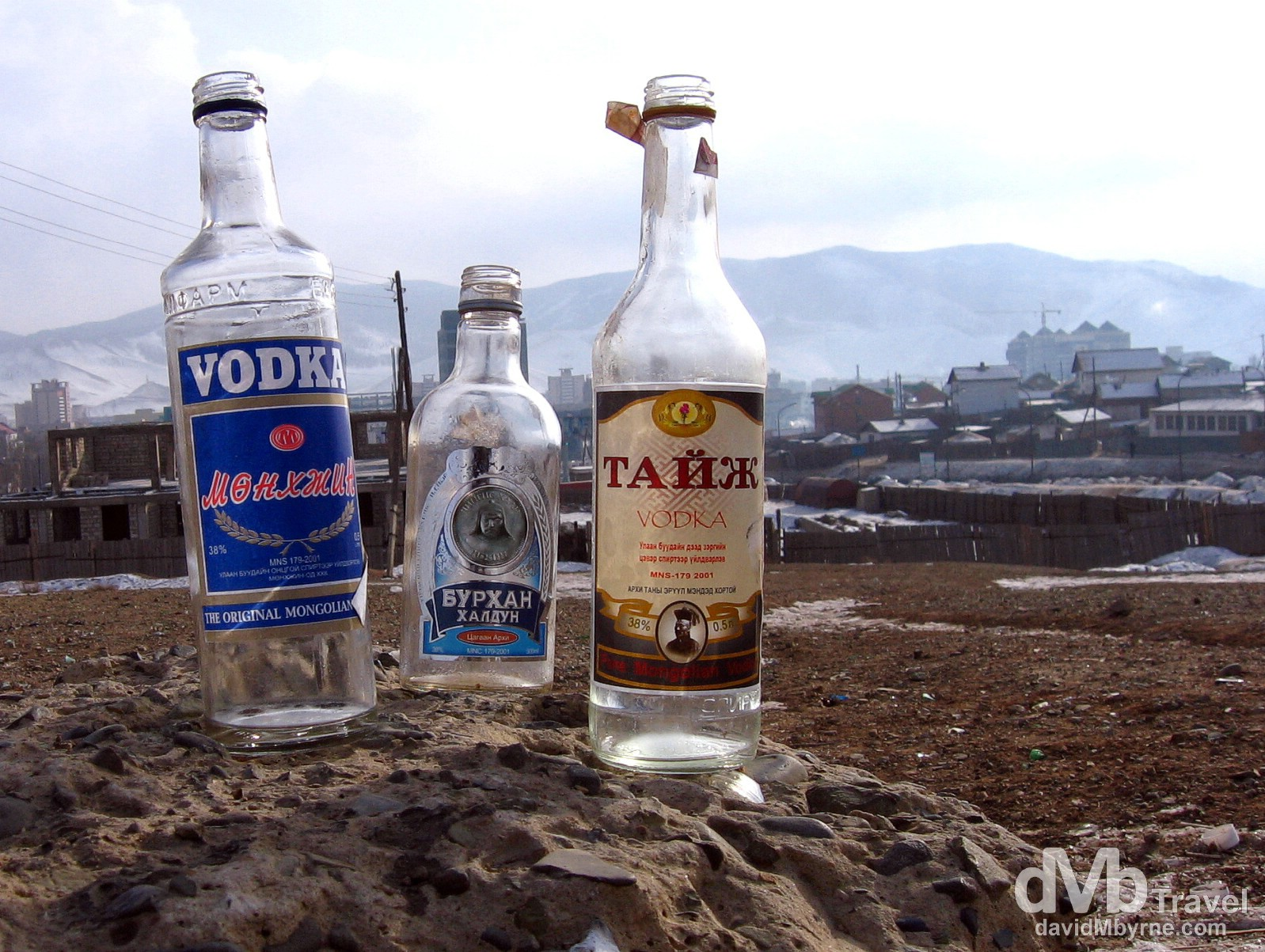 Discarded vodke bottles on Zaany Tolgoi, or Elephant's head, a hill overlooking Ulan Bator, Mongolia. February 15, 2006.
