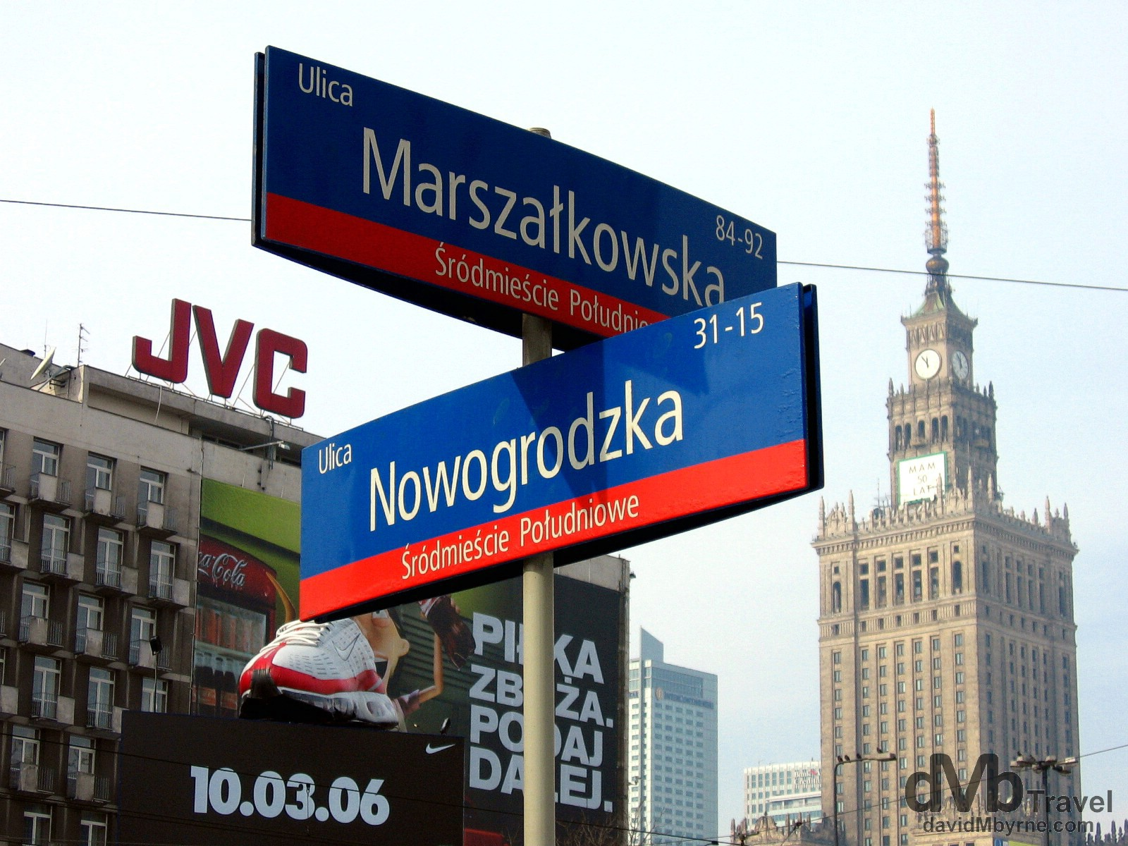 Street signage & the massive tower of the Palace of Culture & Science building as seen from outside Centrum Metro Station in Warsaw, Poland. March 5, 2006.