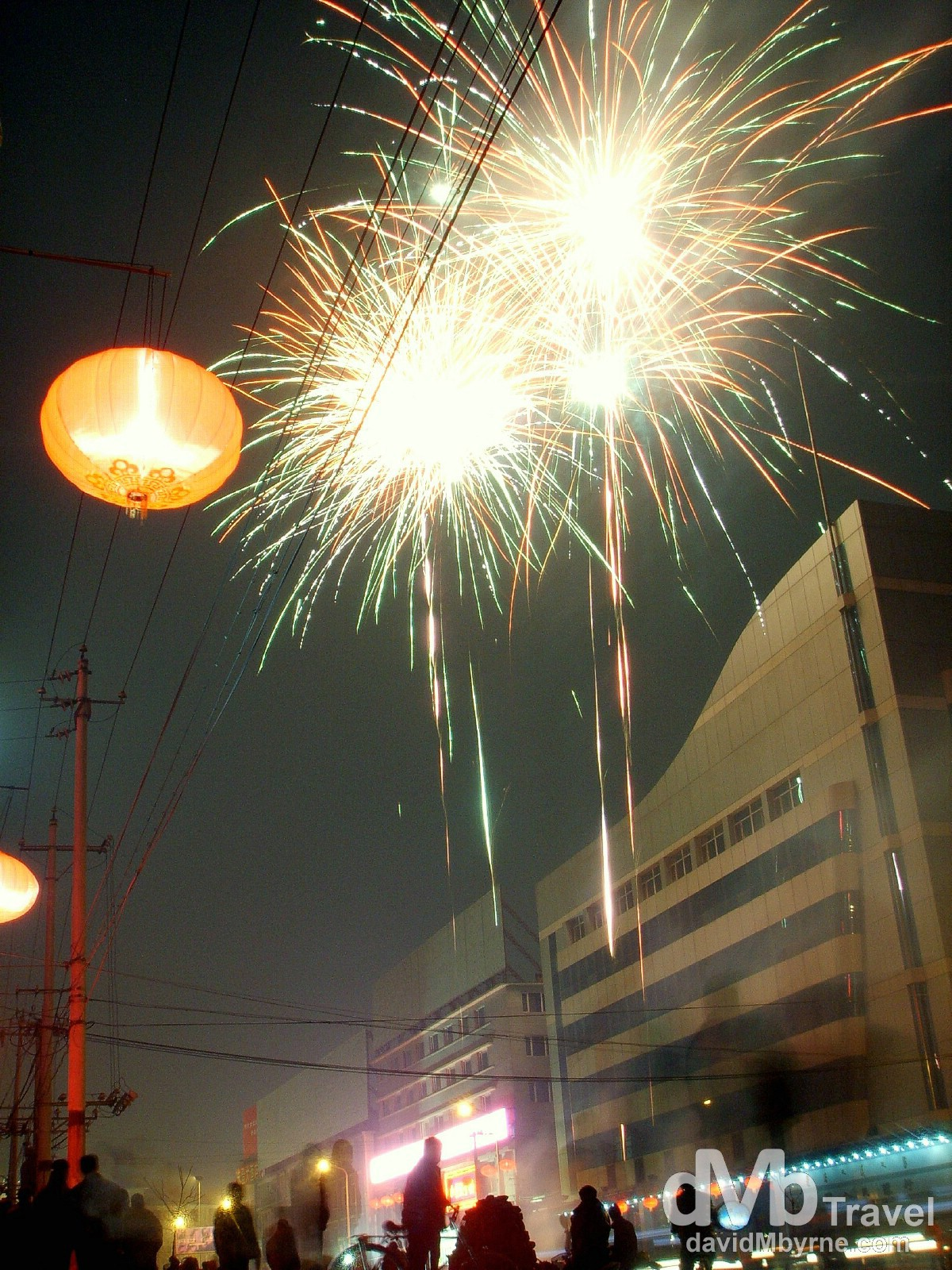Chinese New Year celebration fireworks on the streets of Hohhot, Inner Mongolia, China. February 12, 2006.