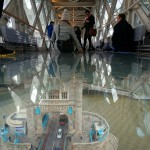 Enjoying the Glass Floor at the Tower Bridge Exhibition in the iconic Tower Bridge over the River Thames in London, England. December 12, 2014.