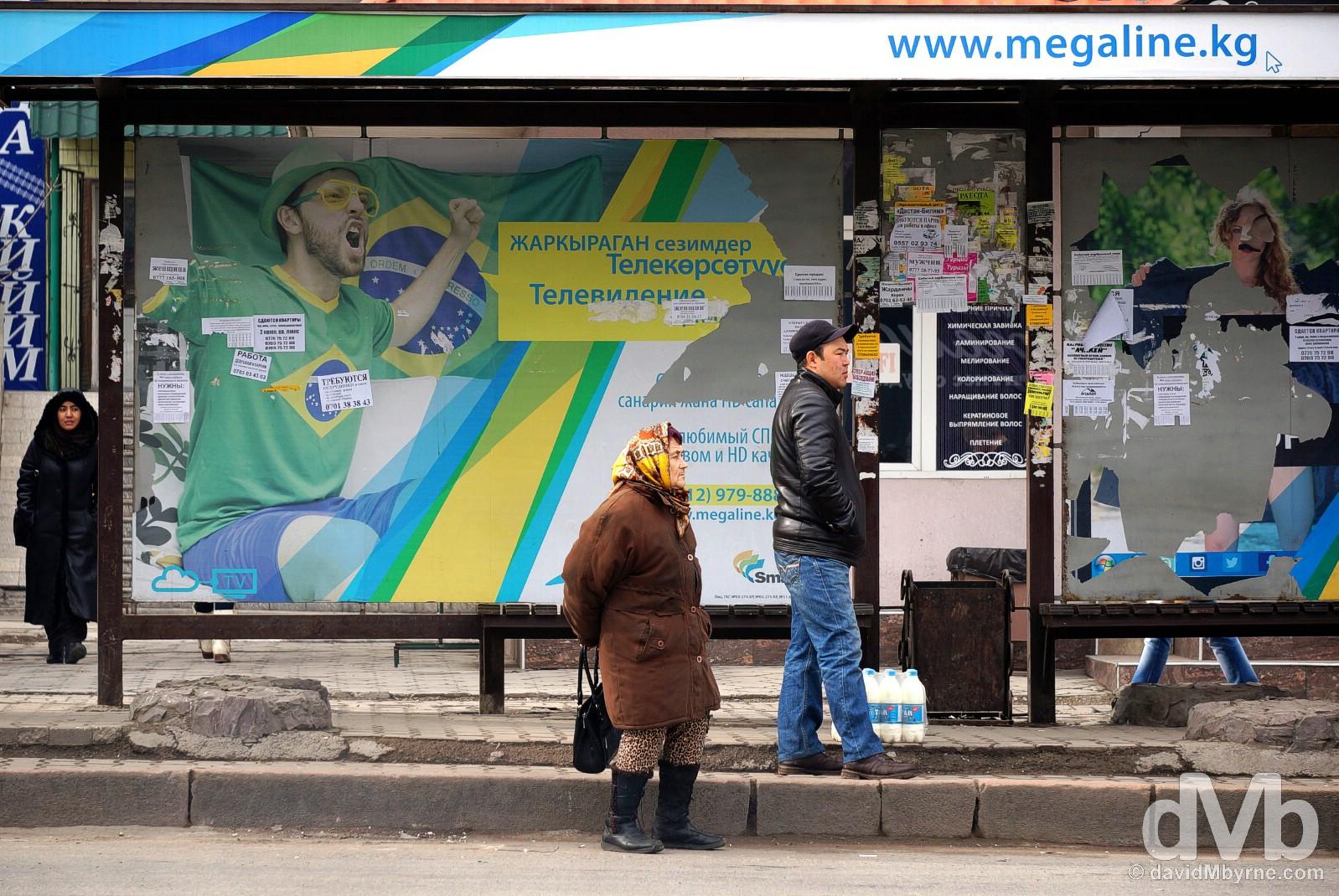 Waiting for the bus on Moskva/Moskovskaya Street in Bishkek, Kyrgyzstan. February 23, 2015.