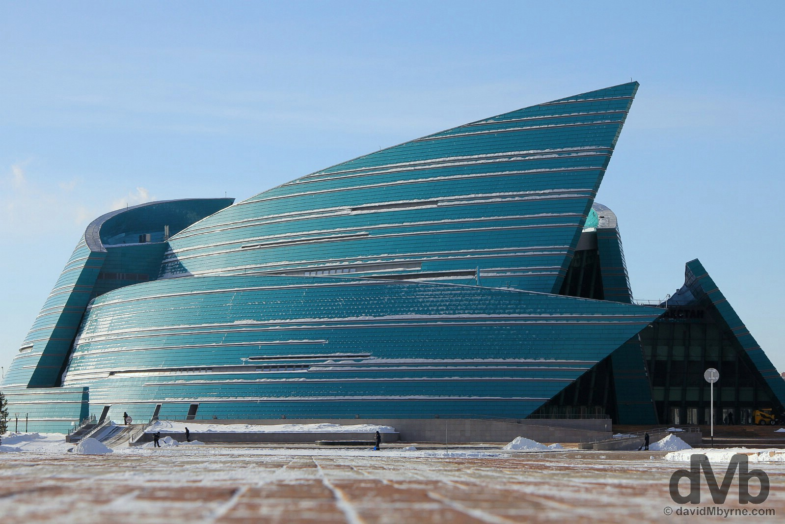 Clearing snow at the base of the Central Concert Hall in Astana, Kazakhstan. February 18, 2015.