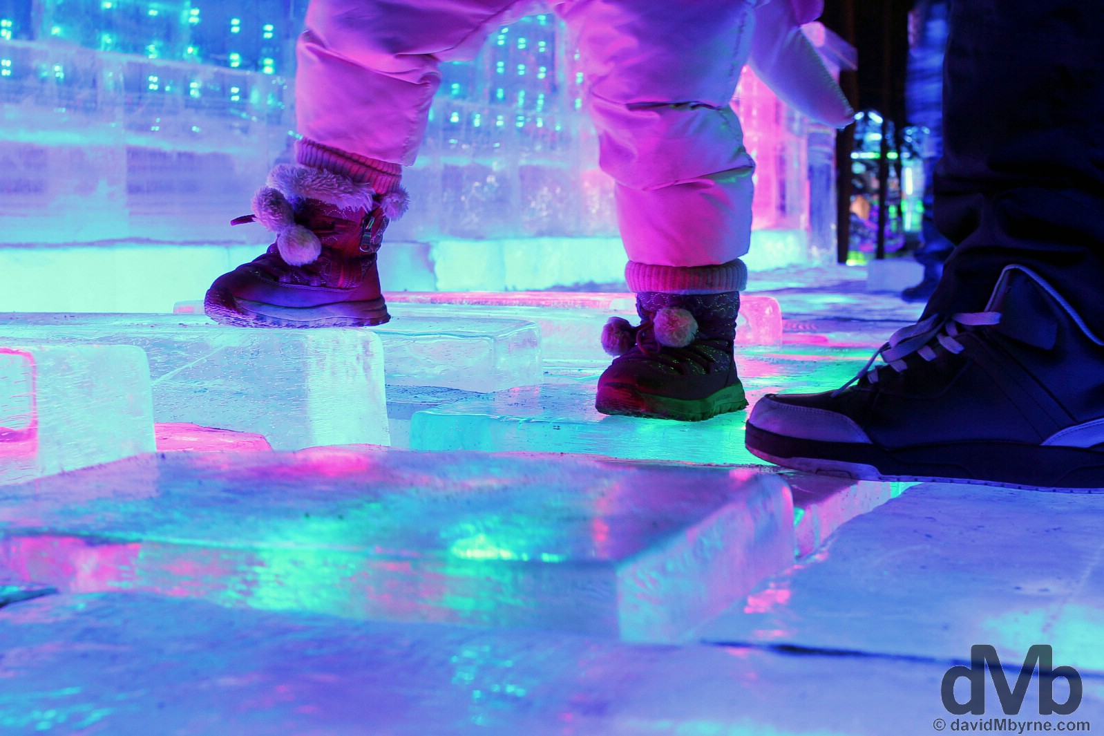 Little & not so little feet on the ice piano in Zhaolin Park as part of the annual International Ice and Snow Sculpture Festival in Harbin, China. February 6, 2015.
