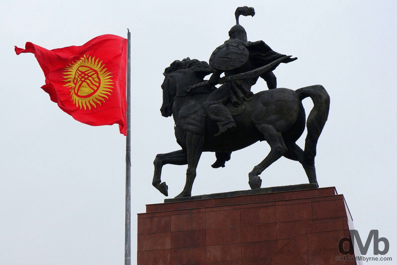 The Manas statue and Kyrgyz flag in Ala-Too Square, central Bishkek. February 25, 2005.