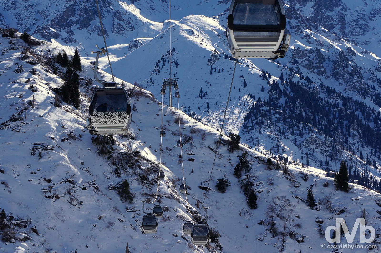 Gondolas of the Shymbulak Ski Resort cable car system on the slopes of the Zailiysky Alatau range in southern Kazakhstan. February 14, 2015.