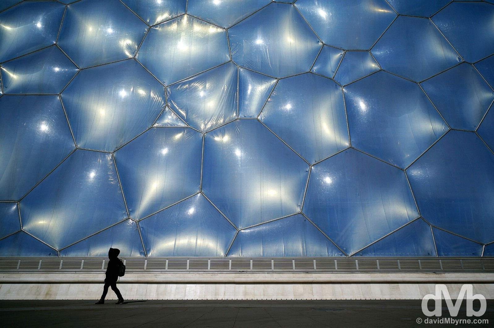 Walking past the National Aquatic Centre, a.k.a. the Water Cube, in Beijing Olympic Park, Beijing, China. February 5, 2015.