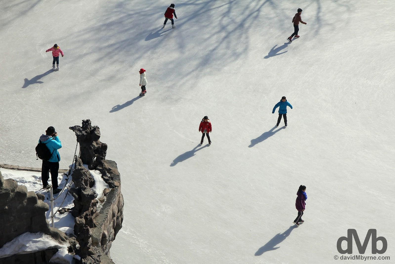 Overlooking skaters in Hongshan (Red Hill) Park, Urumqi, northwestern China. February 11, 2015.
