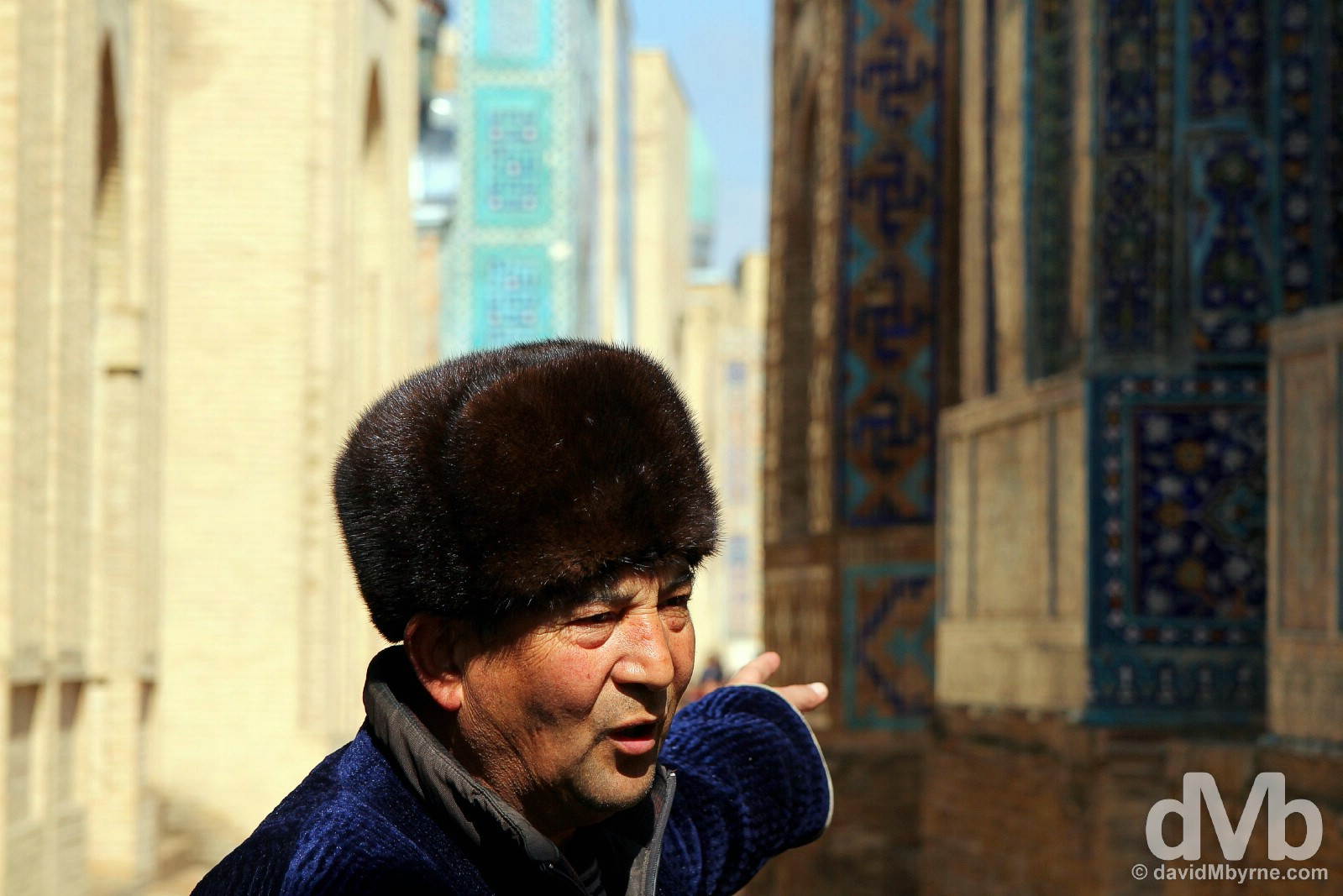 Pointing out detail at the Shah-i-Zinda, the Avenue of Mausoleums, in Samarkand, Uzbekistan. March 8, 2015.