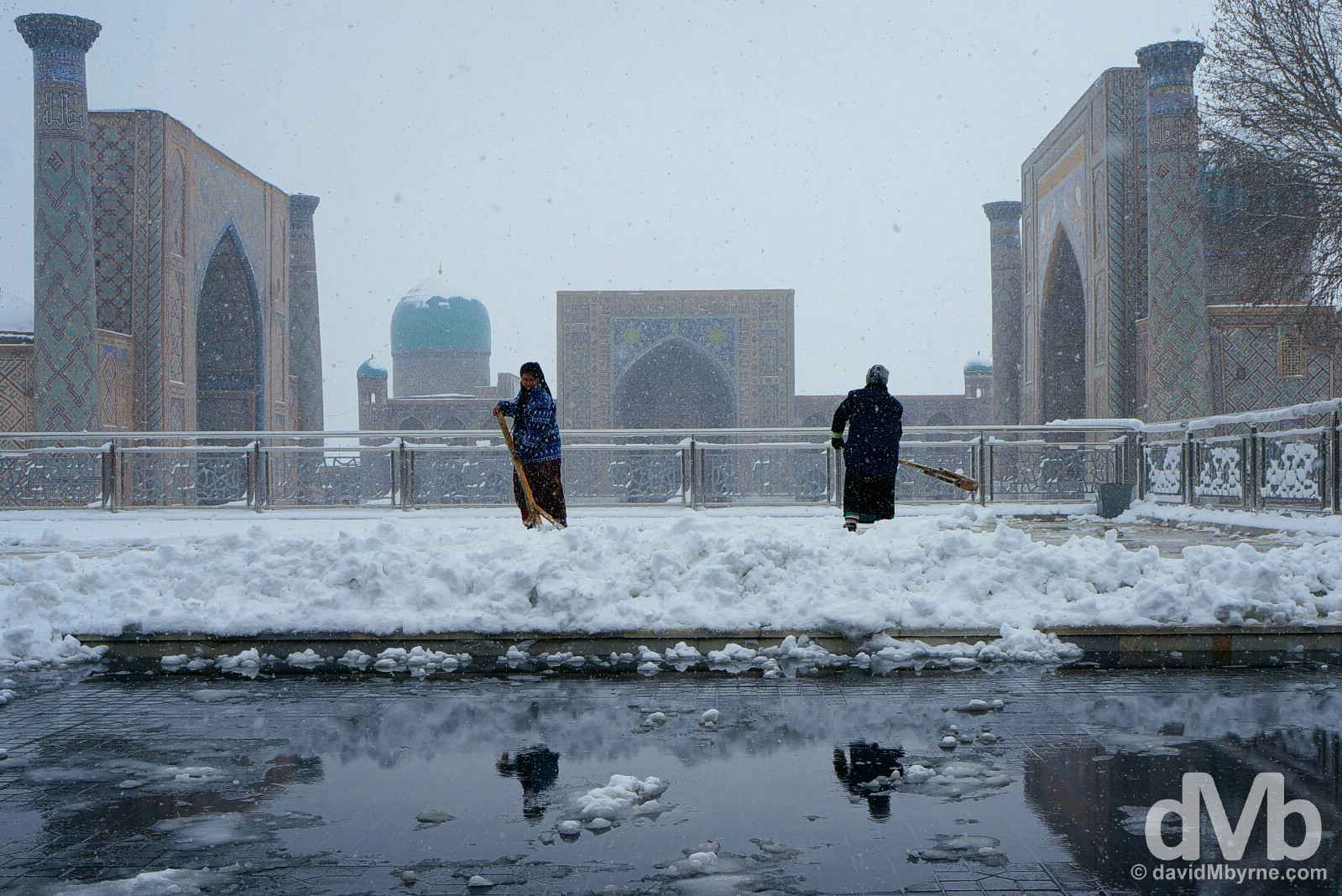 Clearing snow from the viewing platform overlooking the Registan in Samarkand, Uzbekistan. March 10, 2015.
